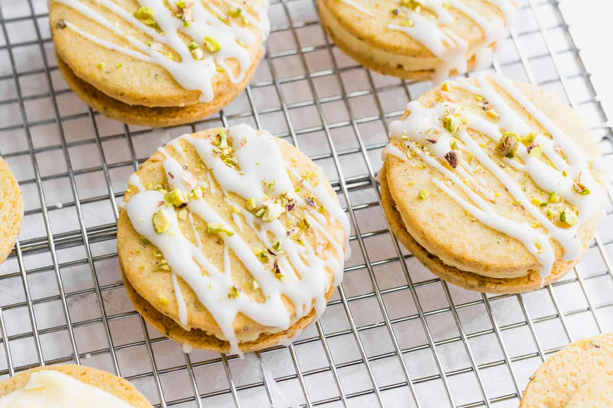 Pistachio and Lemon Cream Sandwich Cookies on a Cooling Rack