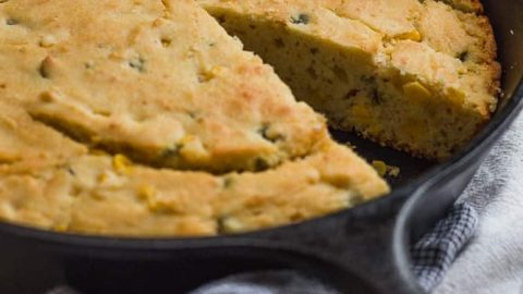 Masa Cornbread in skillet with slice taken out
