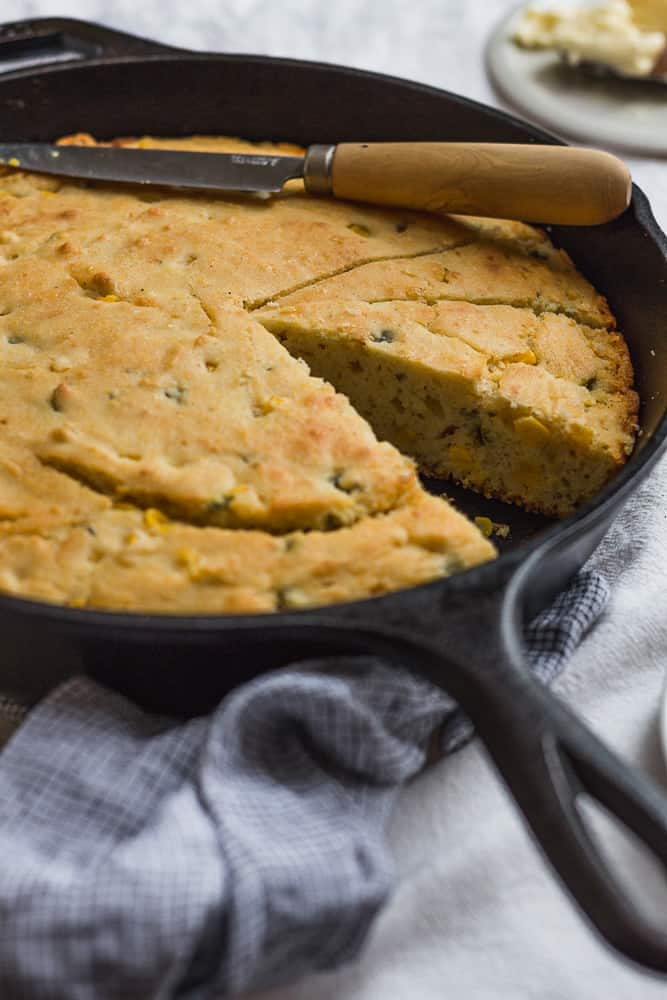 Sliced Cornbread in Cast-Iron Skillet