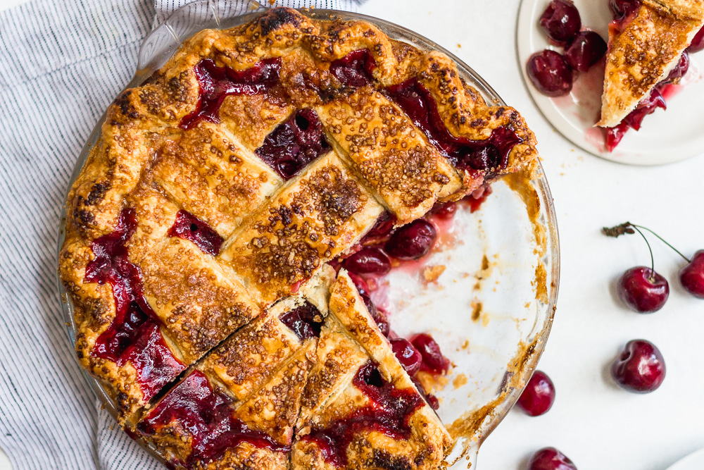 Sliced Cherry Pie with Lattice Topping and fresh cherries