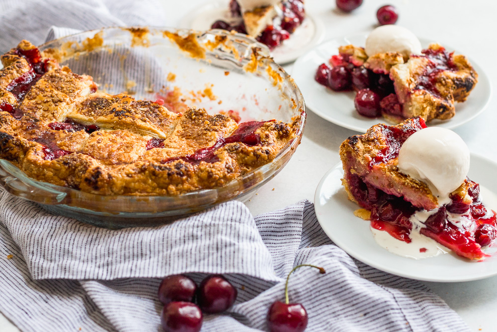 Slices of Cherry Pie with Lattice Topping and Ice Cream