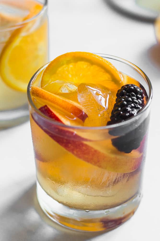 a glass of honey nectarine white wine sangria