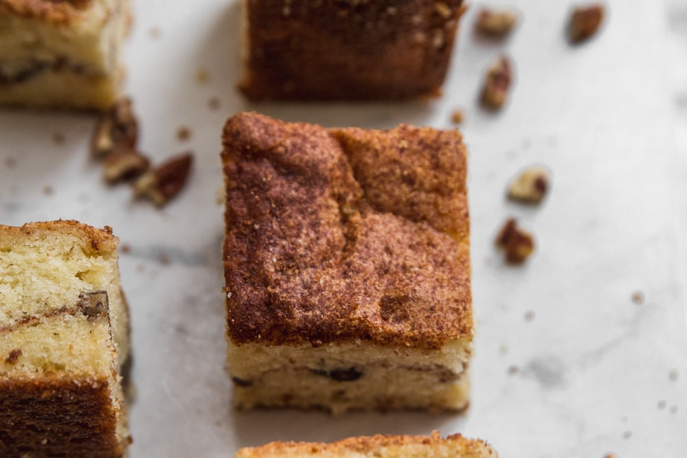 Sour cream coffee cake on marble background