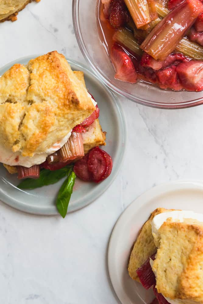Top of Roasted Strawberry Rhubarb Shortcake with basil garnish on a plate