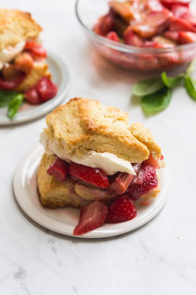 Roasted Strawberry Rhubarb Shortcake with Basil Whipped Cream on plate