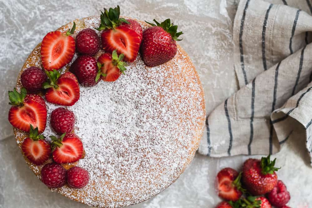 Victoria Sponge sandwich with strawberries and raspberries with linen napkin