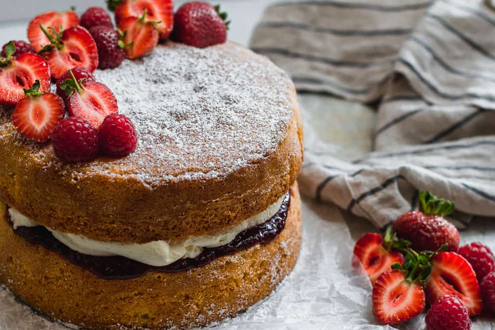Victoria Sponge sandwich with strawberries, raspberries, cream and jam