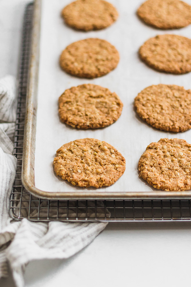 baking sheet with hobnobs on a cooling rack