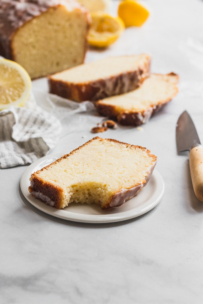 slice of lemon drizzle cake with bite taken