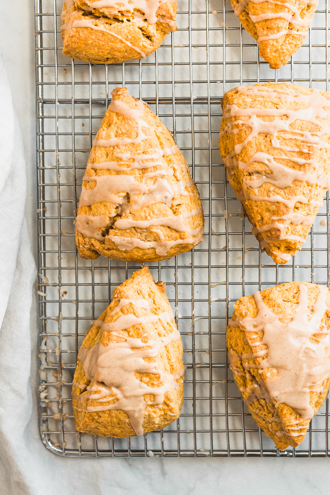 Pumpkin Scones with Cinnamon Maple Glaze on a cooling rack