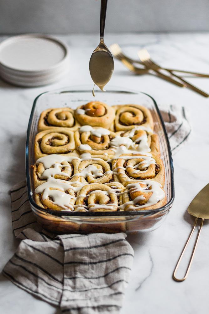 Baking dish with pumpkin butter cinnamon rolls on a linen napkin