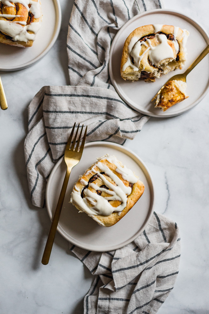 Pumpkin butter cinnamon rolls on plates