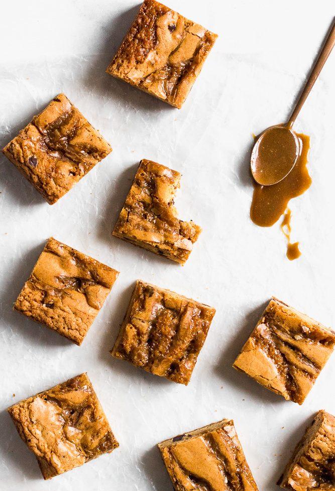 Bourbon Butterscotch Blondies with spoon of gooey butterscotch